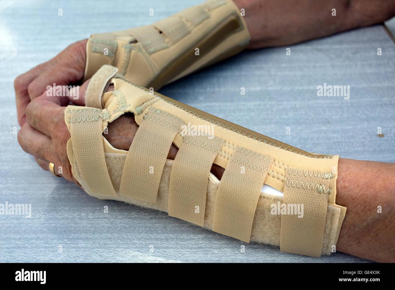 Arthritic hand in Ossur neoprene arthritis wrist brace UK - Stock Image