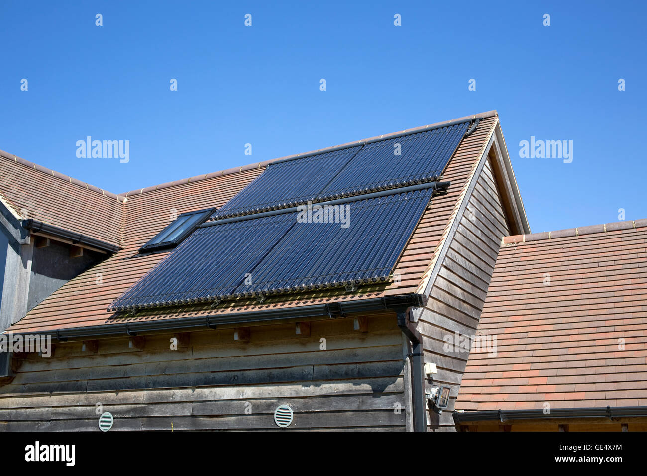 Evacuated tubes of solar thermal array Colemans Hill Farm Mickleton UK Stock Photo