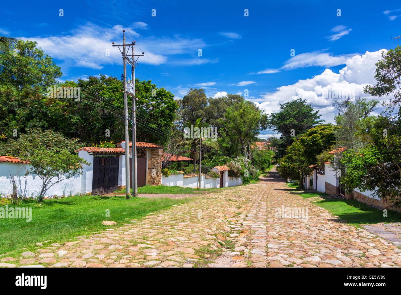 Cobblestone street in a quiet neighborhood of Villa de Leyva, Colombia - Stock Image