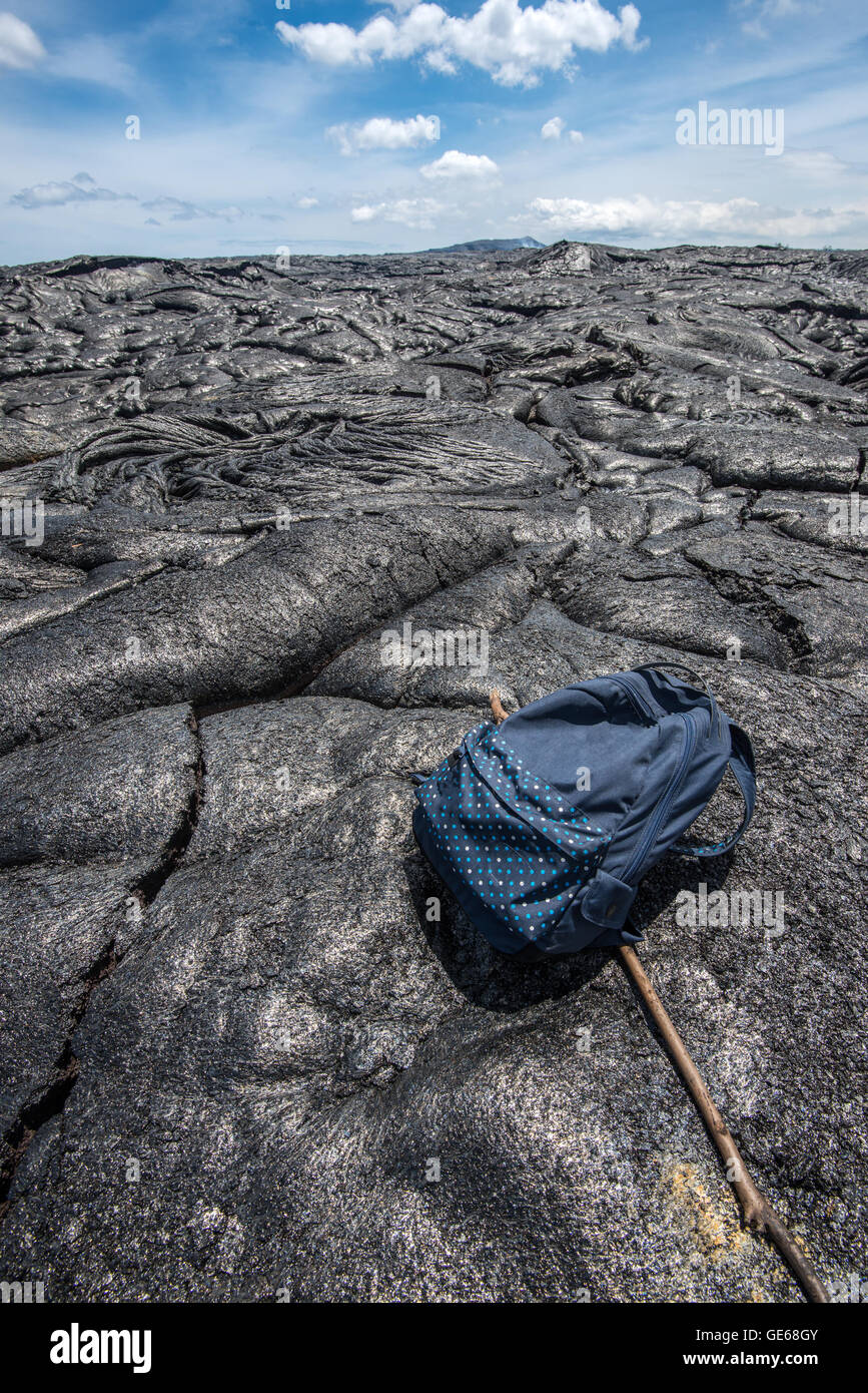 Backpack on the lava field in Hawaii - Stock Image