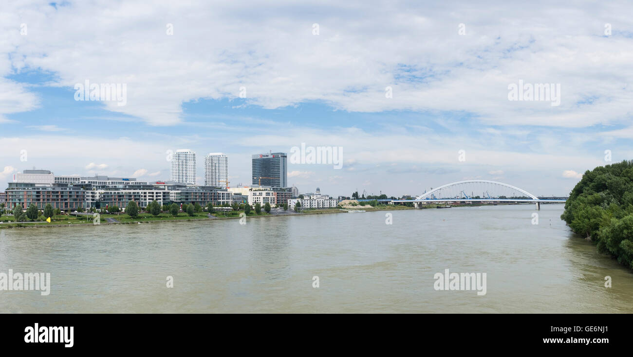 Danube River, Bratislava, Slovakia and Apollo Bridge  and Eurovea shopping mall in a summer day - Stock Image