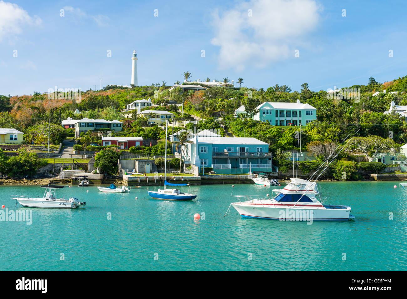 Pleasure boats in Jew's Bay, Bermuda, with Gibbs Hill Lighthouse behind, Southampton Parish, Bermuda - Stock Image