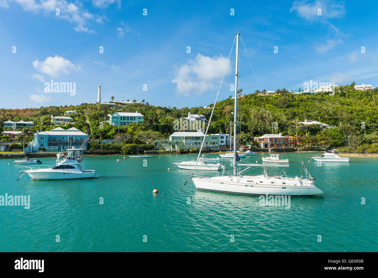 Pleasure boats in Jew's Bay, Bermuda, with Gibbs Hill Lighthouse behind, Southampton Parish, Bermuda - Stock Image