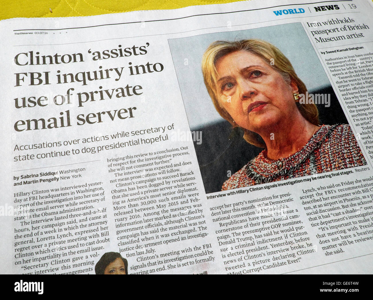 Clinton 'assists' FBI inquiry into use of private email server'  in Observer newspaper article 3 July - Stock Image