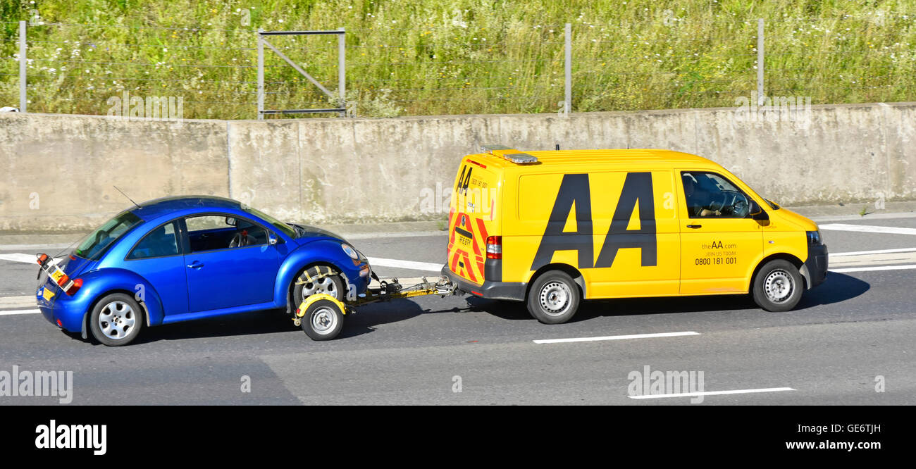 AA breakdown van towing a VW Beetle car on the M25 motorway Essex England UK - Stock Image