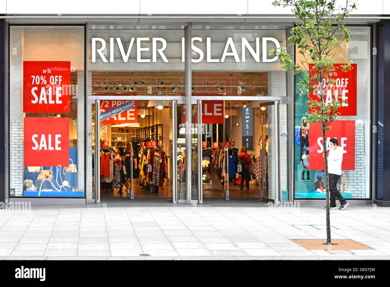 2256b9748 Sale discount posters in store windows at River Island clothing shop front  & entrance in Oxford Street West End London shopping street in England UK