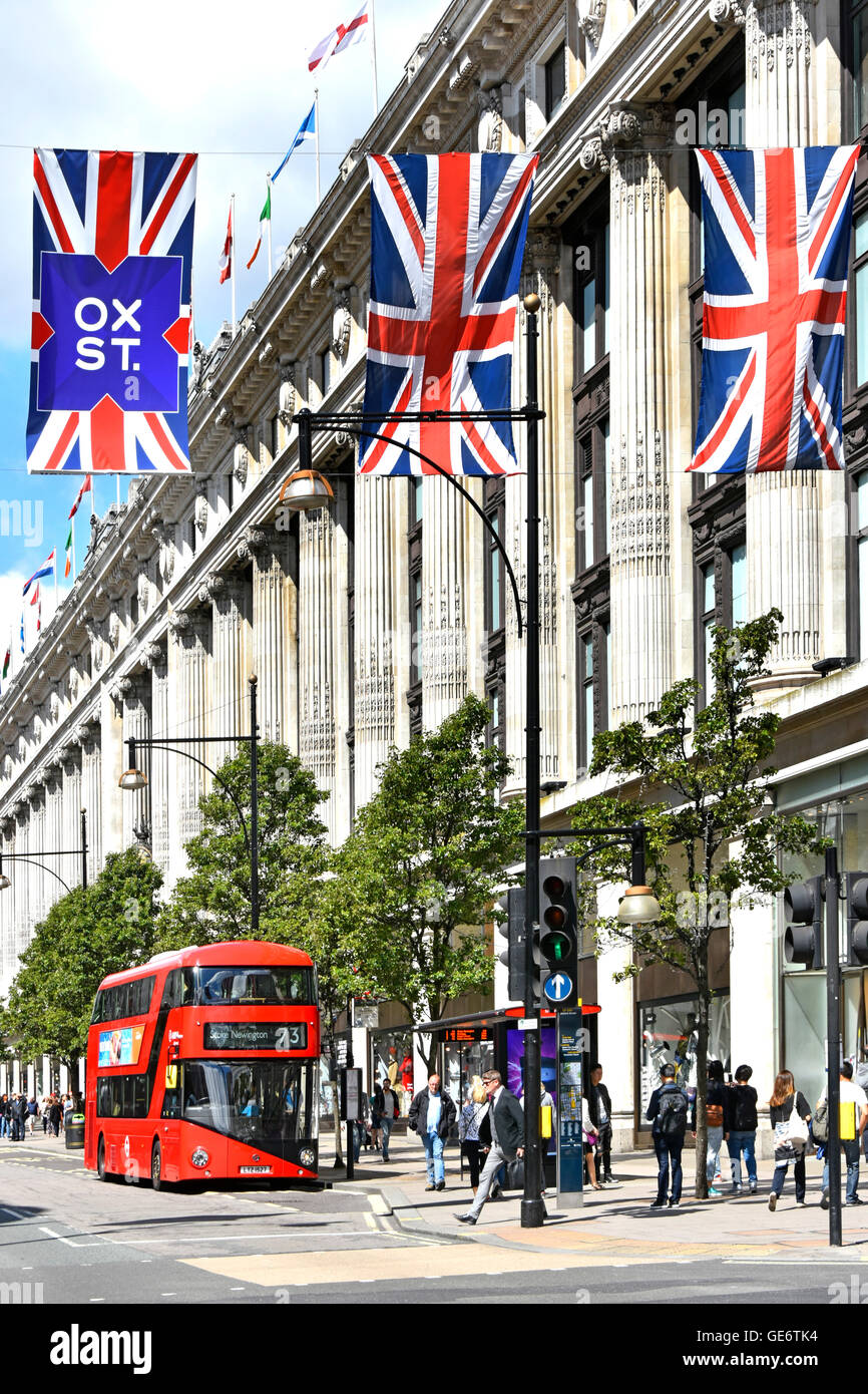 London new red routemaster double decker at bus stop outside Selfridges Department Store in Oxford Street London - Stock Image