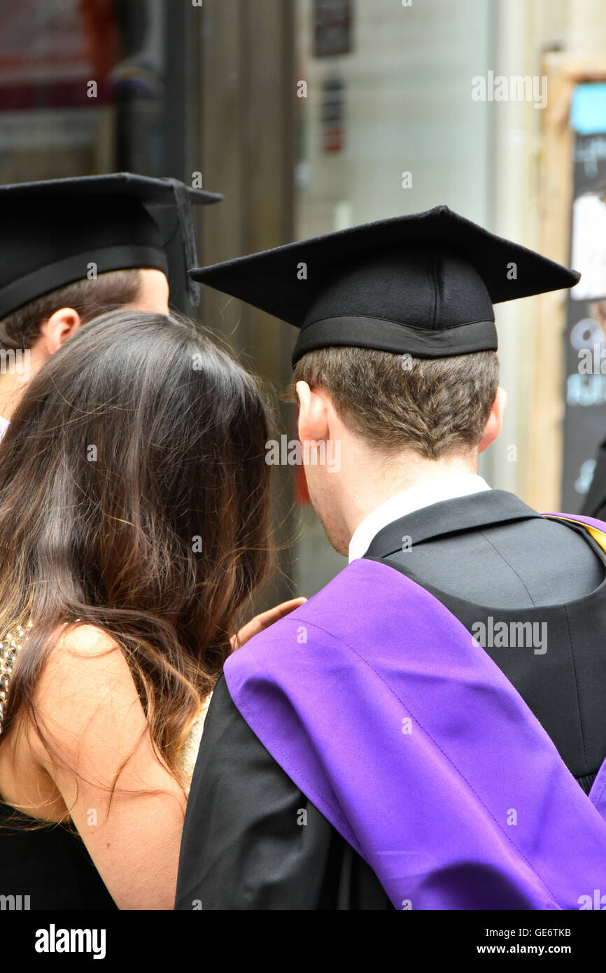 London School of Economics and Political Science male student  graduation day ceremony back view showing LSE gown - Stock Image