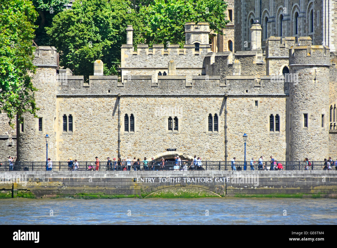 Sign for a water gate on River Thames for historical Traitors' Gate that gave direct waterborne access to historic - Stock Image