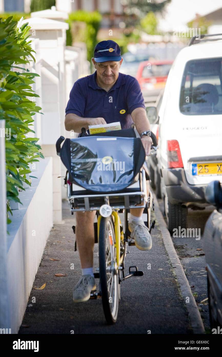 Postman Jacques Tapon rides his bicycle on his daily route in Montbazon, France, 25 June 2008. - Stock Image