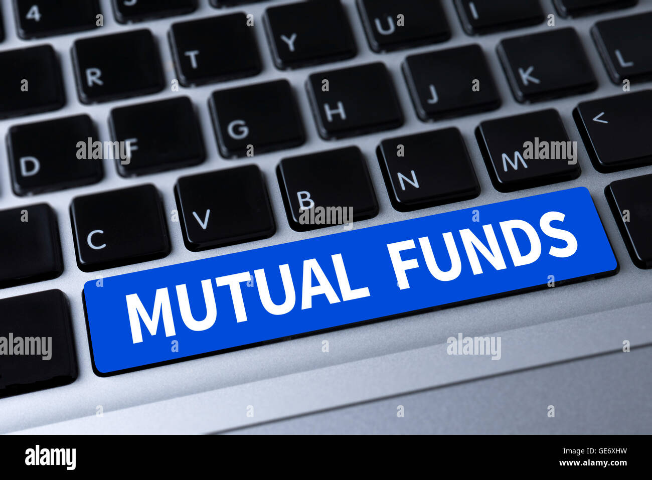 MUTUAL FUNDS a message on keyboard - Stock Image