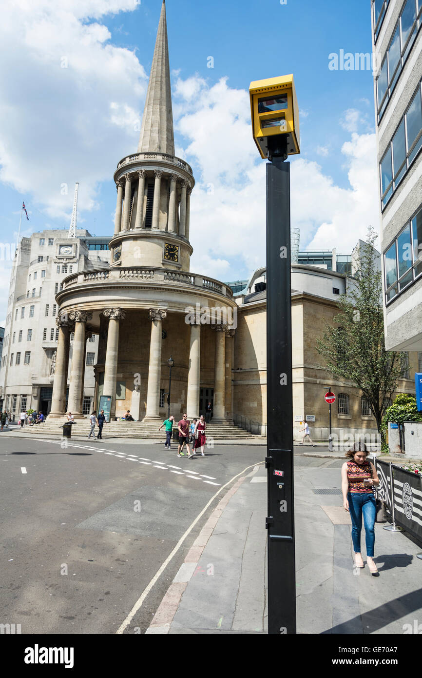 Big brother type surveillance cameras near All Souls Church on Langham Place, London, UK - Stock Image