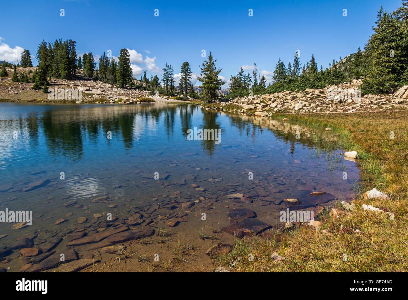 Reflections on  Lofty Lake, Mirror Lake Scenic Byway, Utah - Stock Image