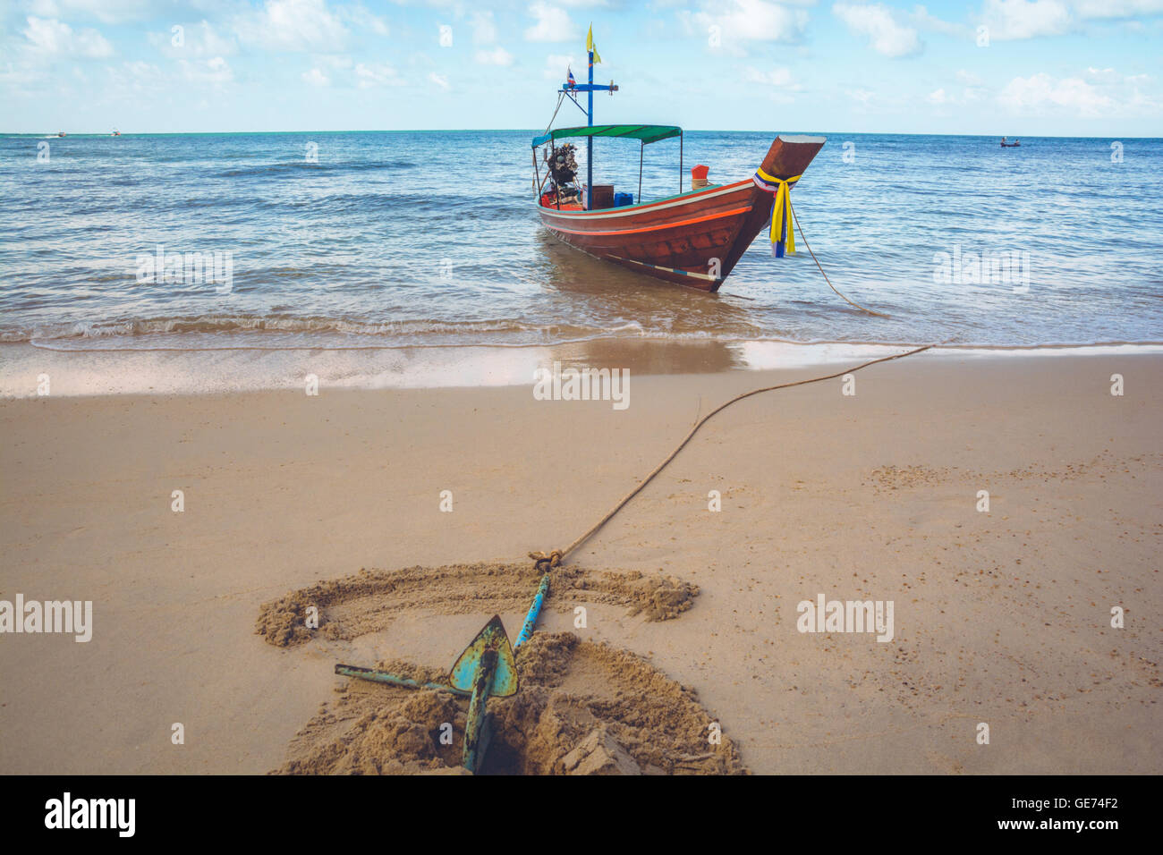 A boat is anchored at Bottle Beach, Koh Pha Ngan, Thailand Stock Photo