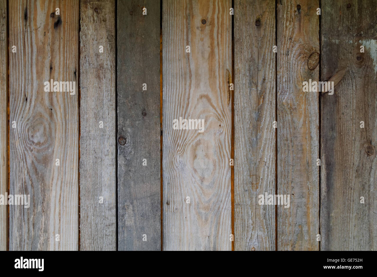 old rough knaggy weathered planks as texture - Stock Image