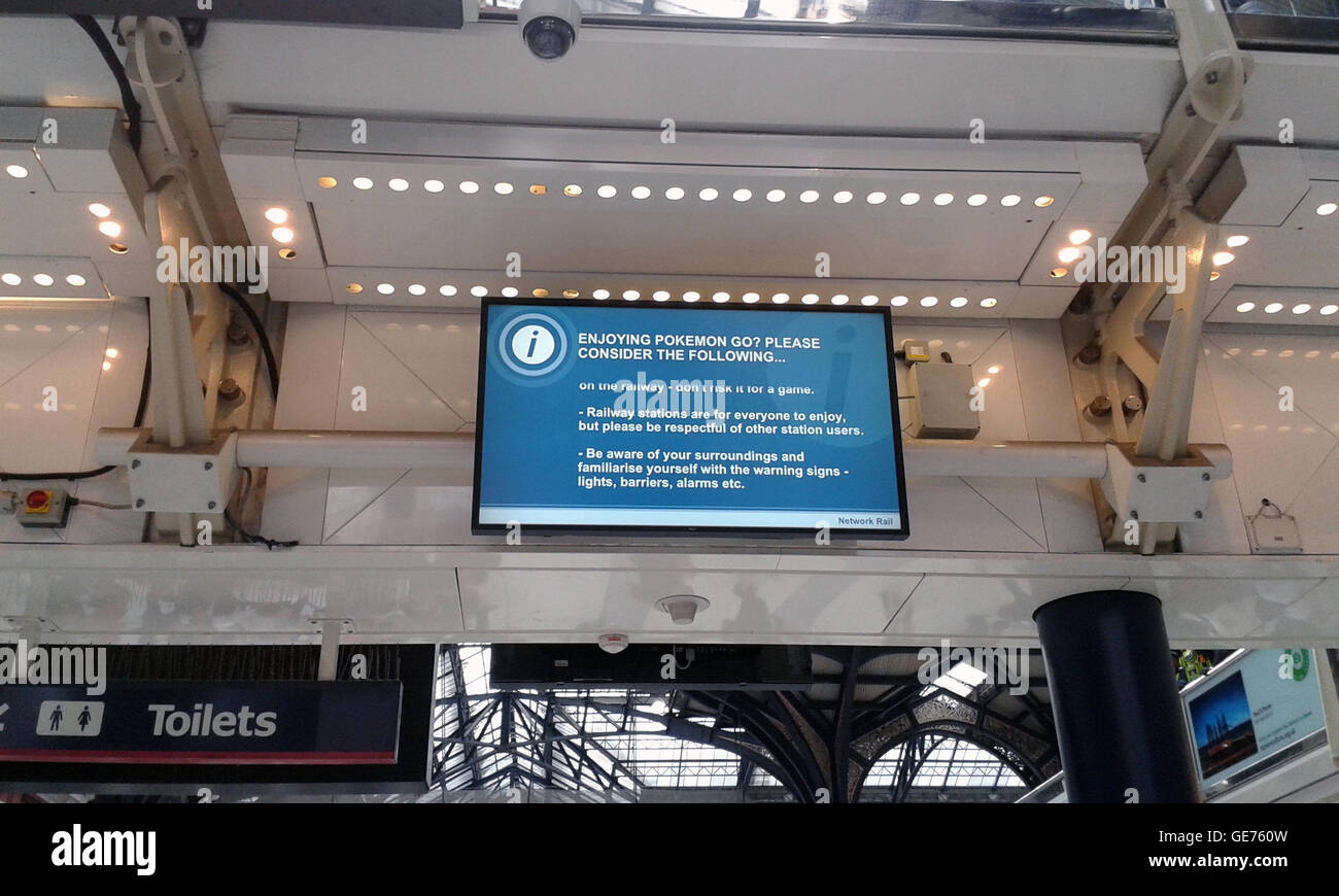 Pokeman Go safety warning sign at London Liverpool Street Station, July 2016, UK - Stock Image