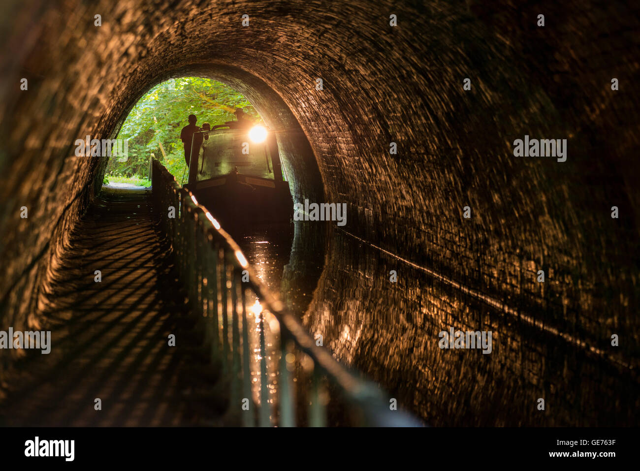 A canal boat passing through Ellesmere Tunnel on the Llangollen Canal in Shropshire. - Stock Image