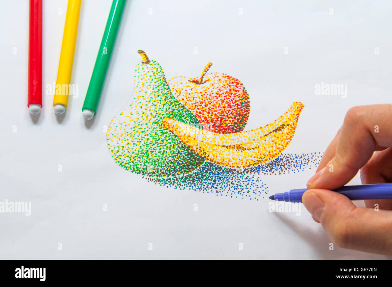 Man's hand drawing a still life using color markers. Pointillism technique. - Stock Image