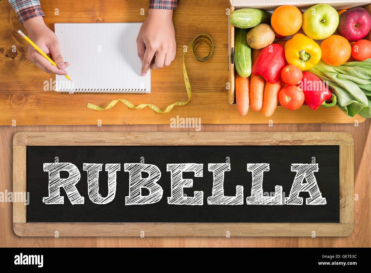 RUBELLA fresh vegetables and  on a wooden table - Stock Image