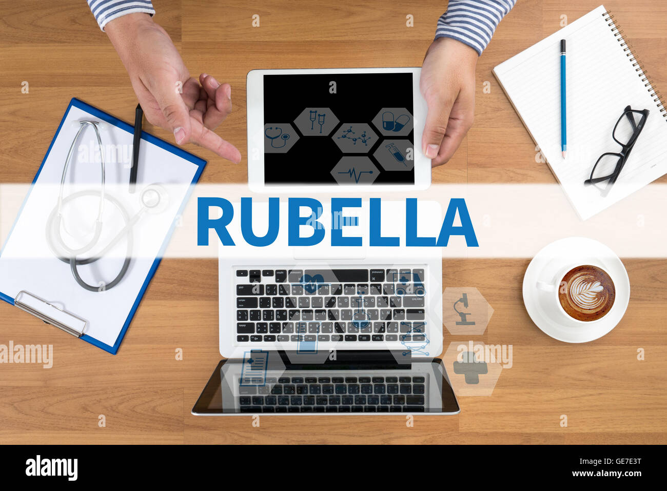 RUBELLA Doctor touch digital tablet, desktop with medical equipment on background, top view, coffee Stock Photo