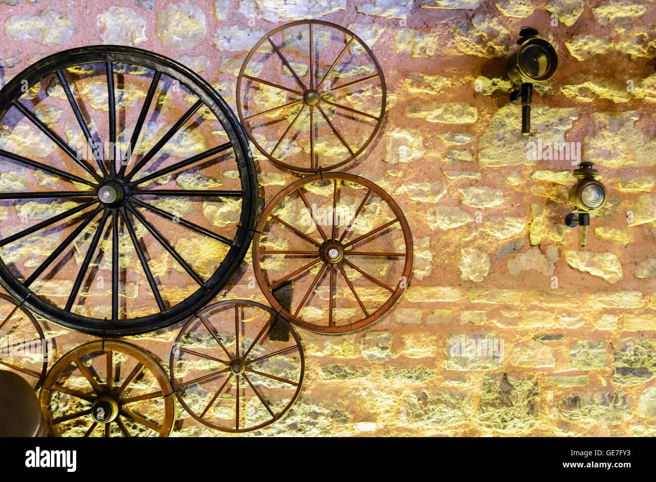 Old Wagon Wheel On Stone Stock Photos & Old Wagon Wheel On Stone ...