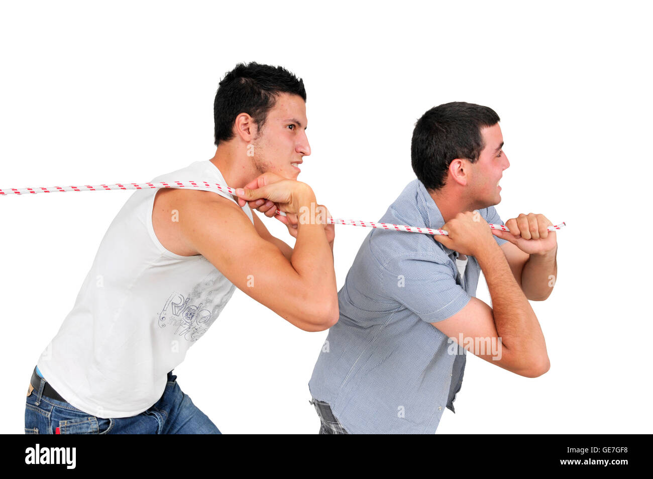 Two middle eastern young men pulling the burden together - Stock Image