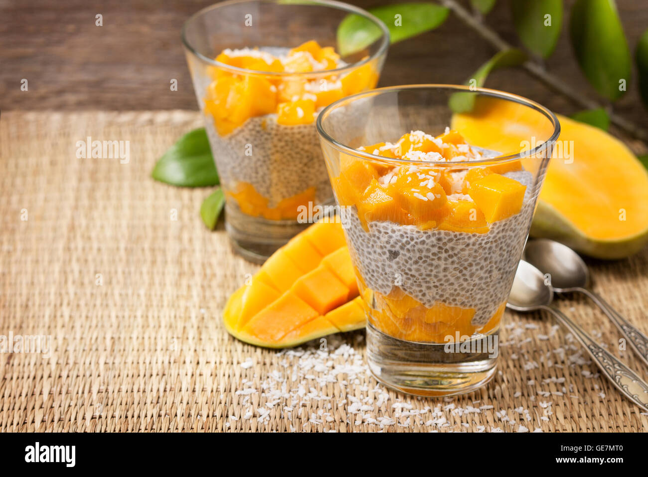 chia pudding with soy (coconut, almond) milk and mango pieces in a glass (vegan, gluten-free) - Stock Image