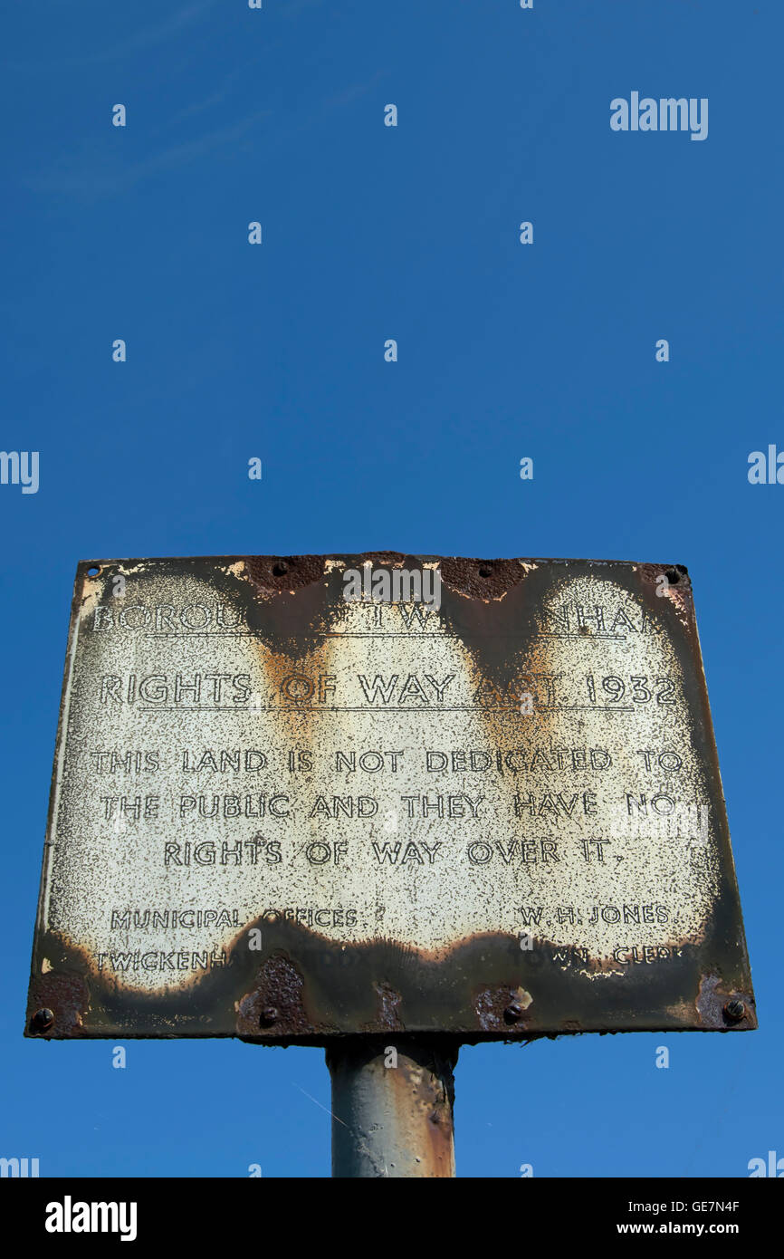 rusted british sign giving notice that, under the 1932 rights of way act, the public have no rights of way over - Stock Image