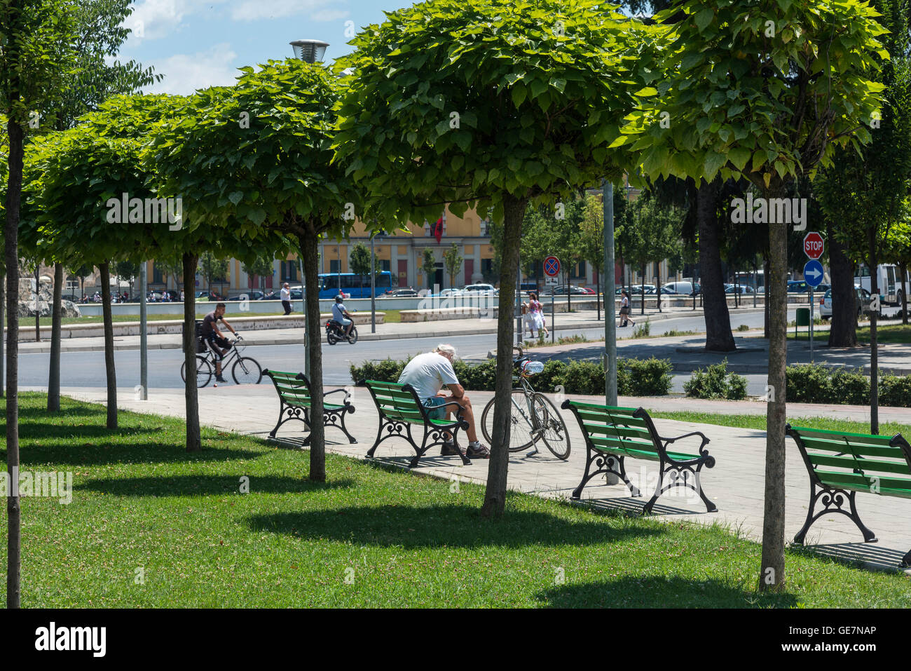 Resting in the park on Skanderbeg Square, Tirana, Albania, - Stock Image