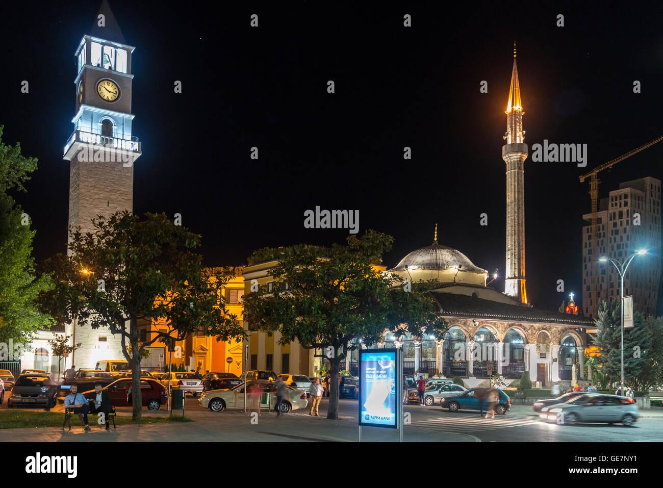 The clock tower and Et'hem Bey Mosque at night on Skanderbeg Square, Tirana, Albania, - Stock Image