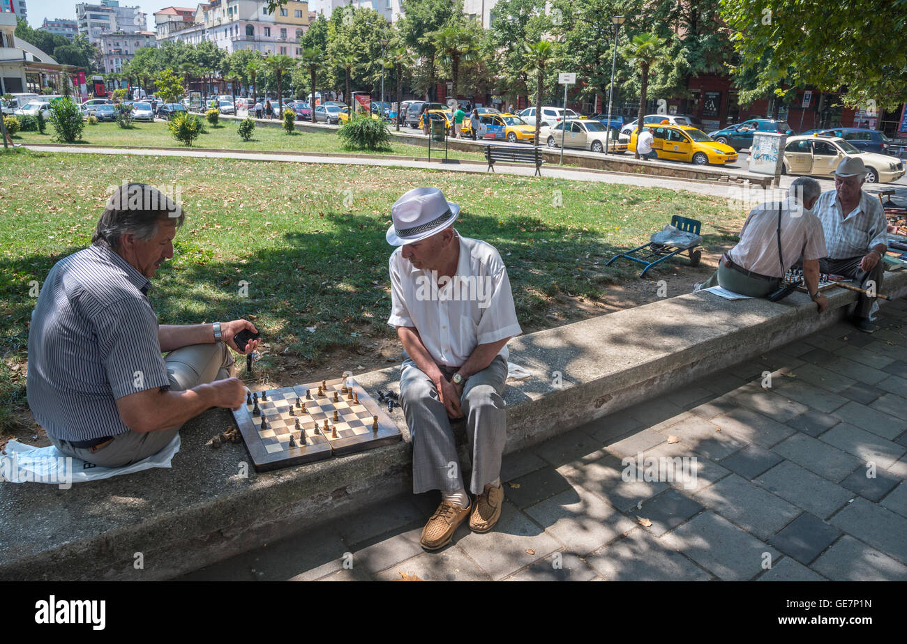 Playing chess, a popular passtime in Albania, on the edge of Rinia Park, Central Tirana, Albania, - Stock Image
