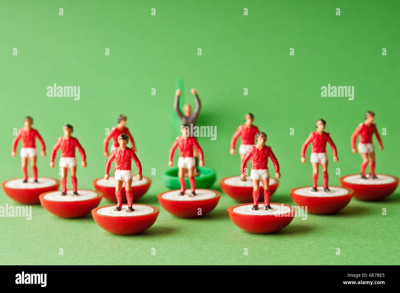 plastic Subbuteo football team with red shirt - Stock Image