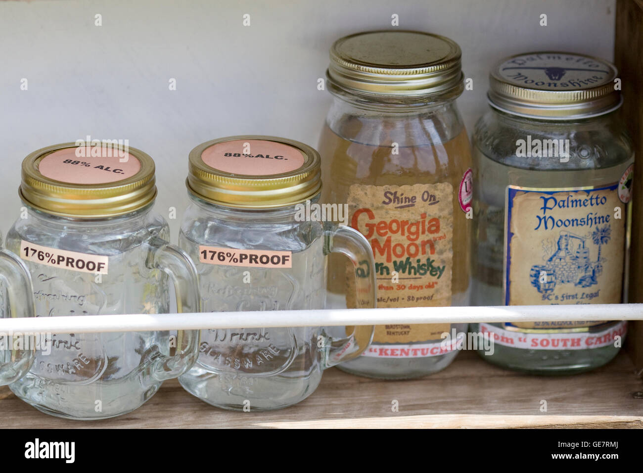 Jars of 176% proof Moonshine whiskey - Stock Image