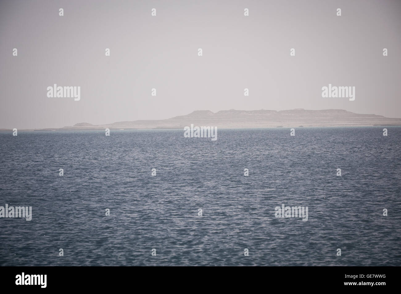 A view of Saudi Arabia over the Inland Sea, which is an inlet of the Arabian Gulf forming a tidal lake. The Inland - Stock Image