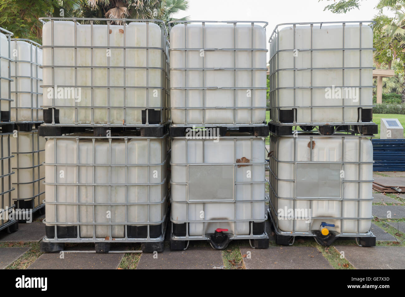 Bulk fluid shipping containers on location ready for shipment - Stock Image