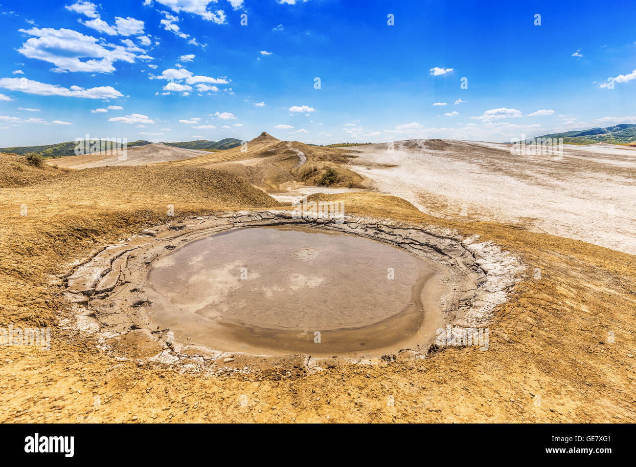 Mud volcano refers to formations created by geo-exuded mud or slurries, water and gases - Stock Image