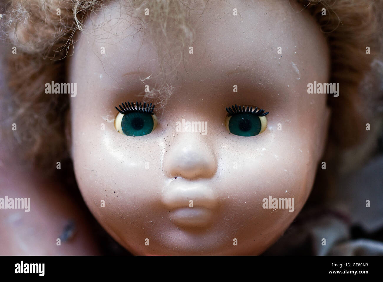 Abandoned doll found in Pripyat kindergarten in the Chernobyl exclusion zone, Ukraine. - Stock Image