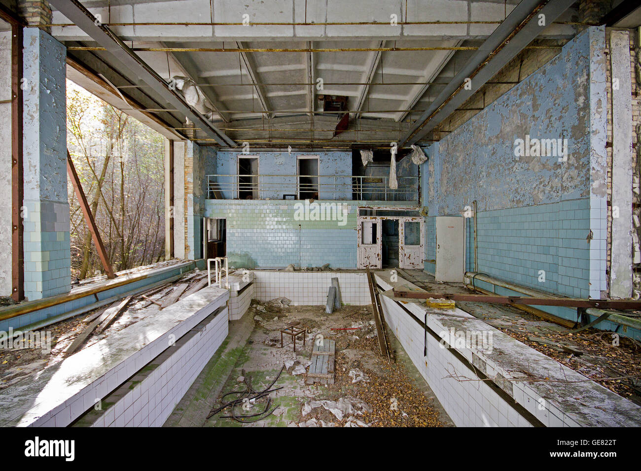 Swimming pool in the abandoned town of Pripyat, Chernobyl exclusion zone, Ukraine. - Stock Image