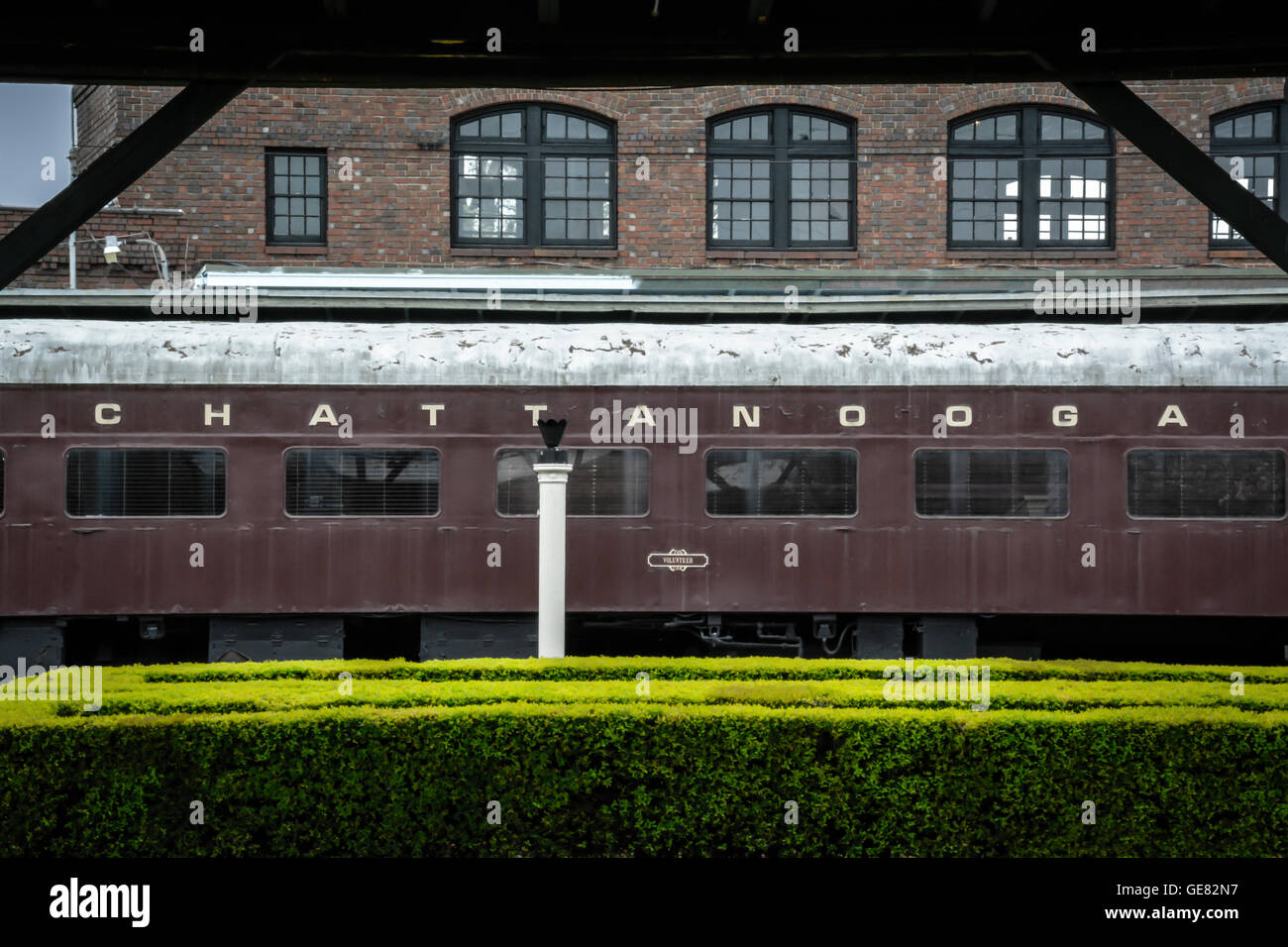 The historical Chattanooga Choo Choo Hotel's vintage branded train car on the tracks along side the garden complex - Stock Image