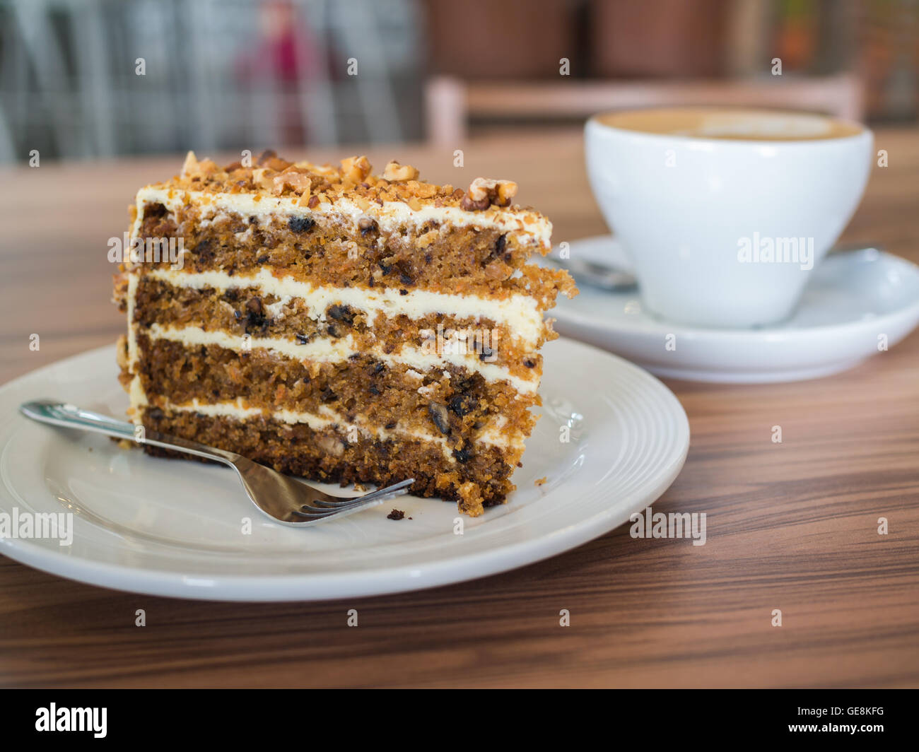 Carrot cake with walnuts on wooden table. selective focus Stock Photo