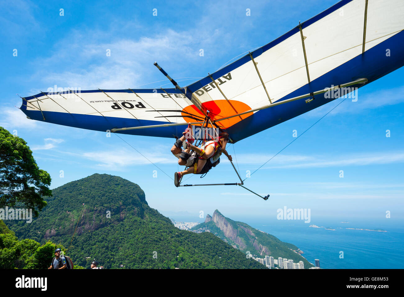 RIO DE JANEIRO - MARCH 22, 2016: A hang gliding instructor takes off with a passenger from Pedra Bonita. - Stock Image