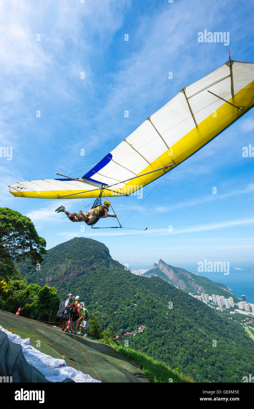 RIO DE JANEIRO - MARCH 22, 2016: A hang gliding instructor takes off with a passenger from the ramp at Pedra Bonita. - Stock Image