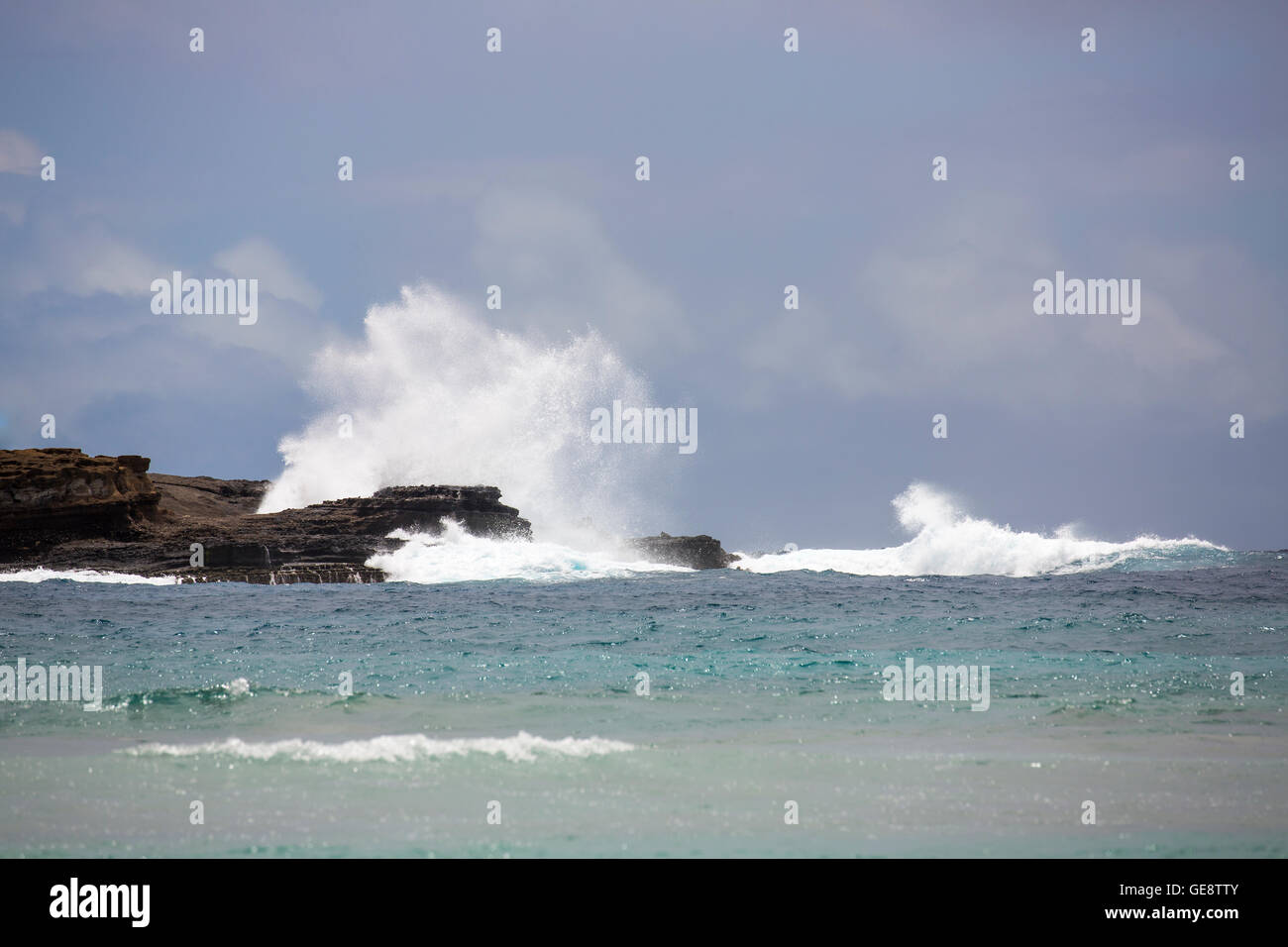 A wave crashing in Hanauma Bay, Hawaii - Stock Image