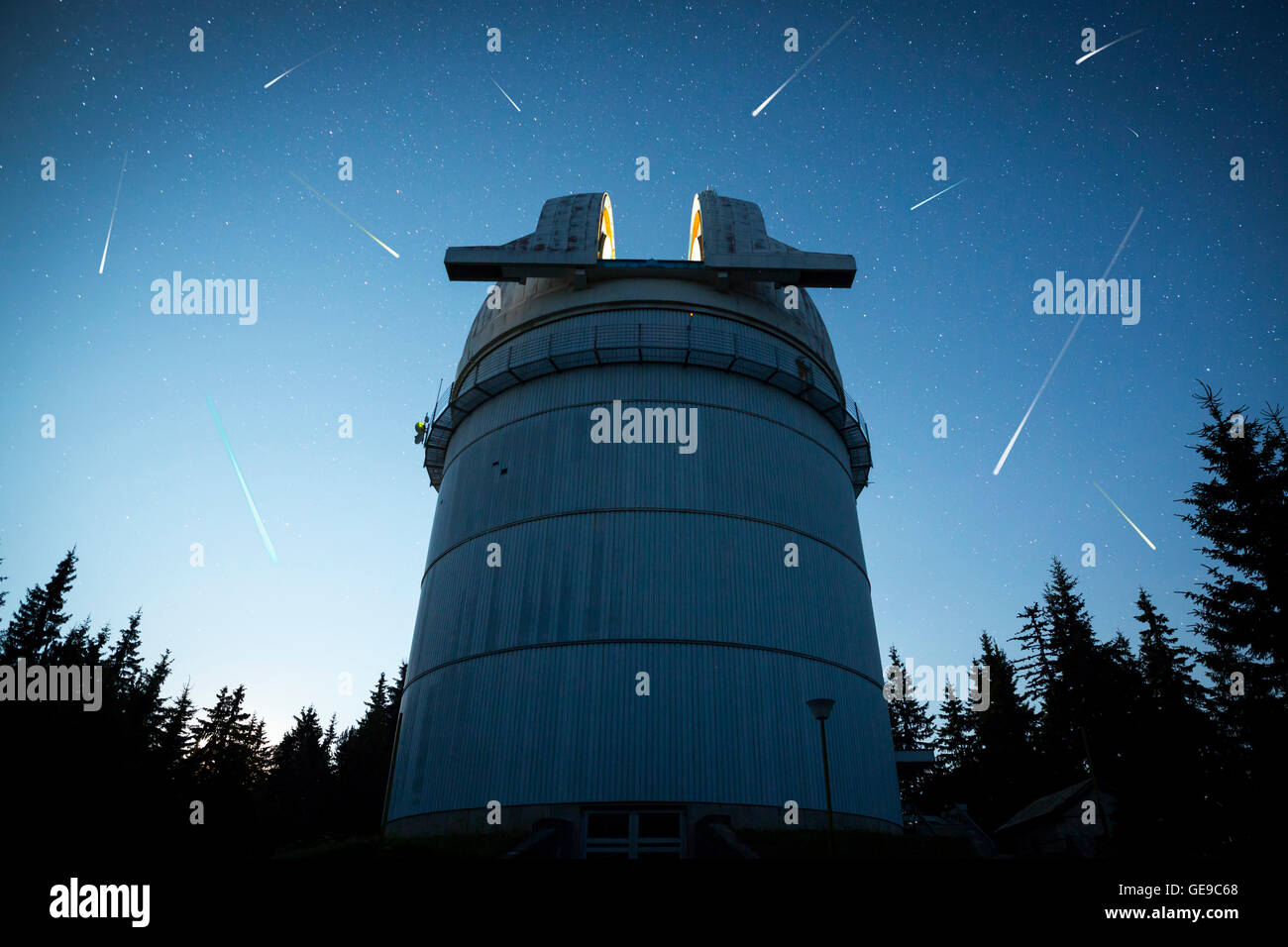 Rozhen astronomical observatory under the night sky stars. Blue sky with hundreds of stars of the Milky way. Bulgarian Stock Photo