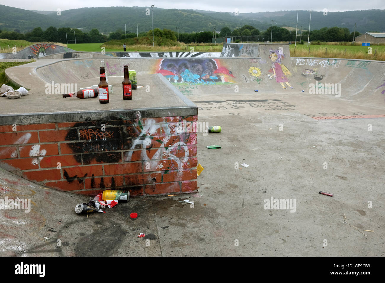 Bottles a rubbish left at the skate park after an outdoor party by village young people. 23rd July 2016 - Stock Image