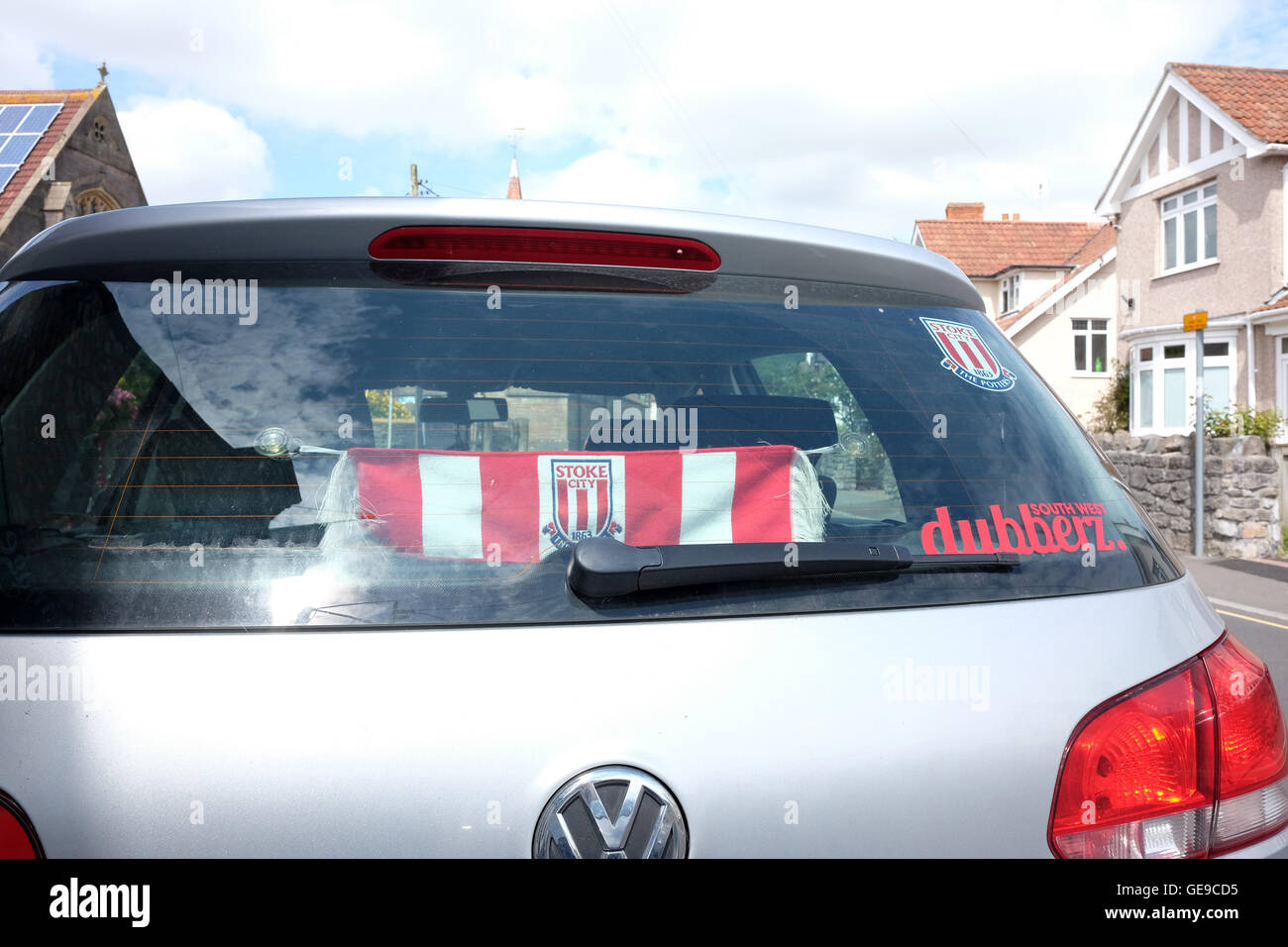 23rd July 2016 -  Stoke City football scarf in the rear window of  a Volkswagen Polo car in the Somerset village - Stock Image