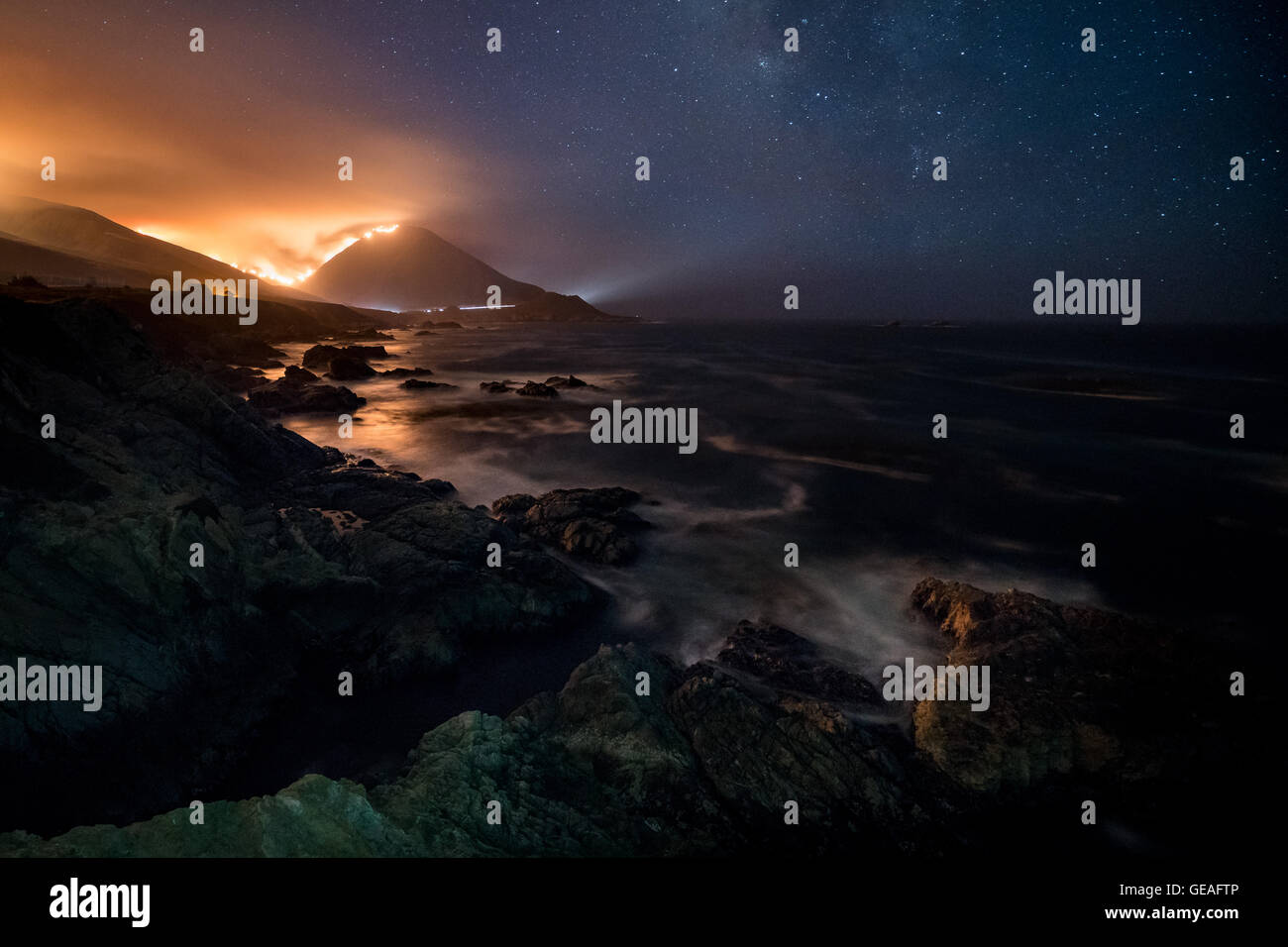 Big Sur, California, USA. 23rd July, 2016. A wildfire is burning out of control at Garrapata State Park which is - Stock Image