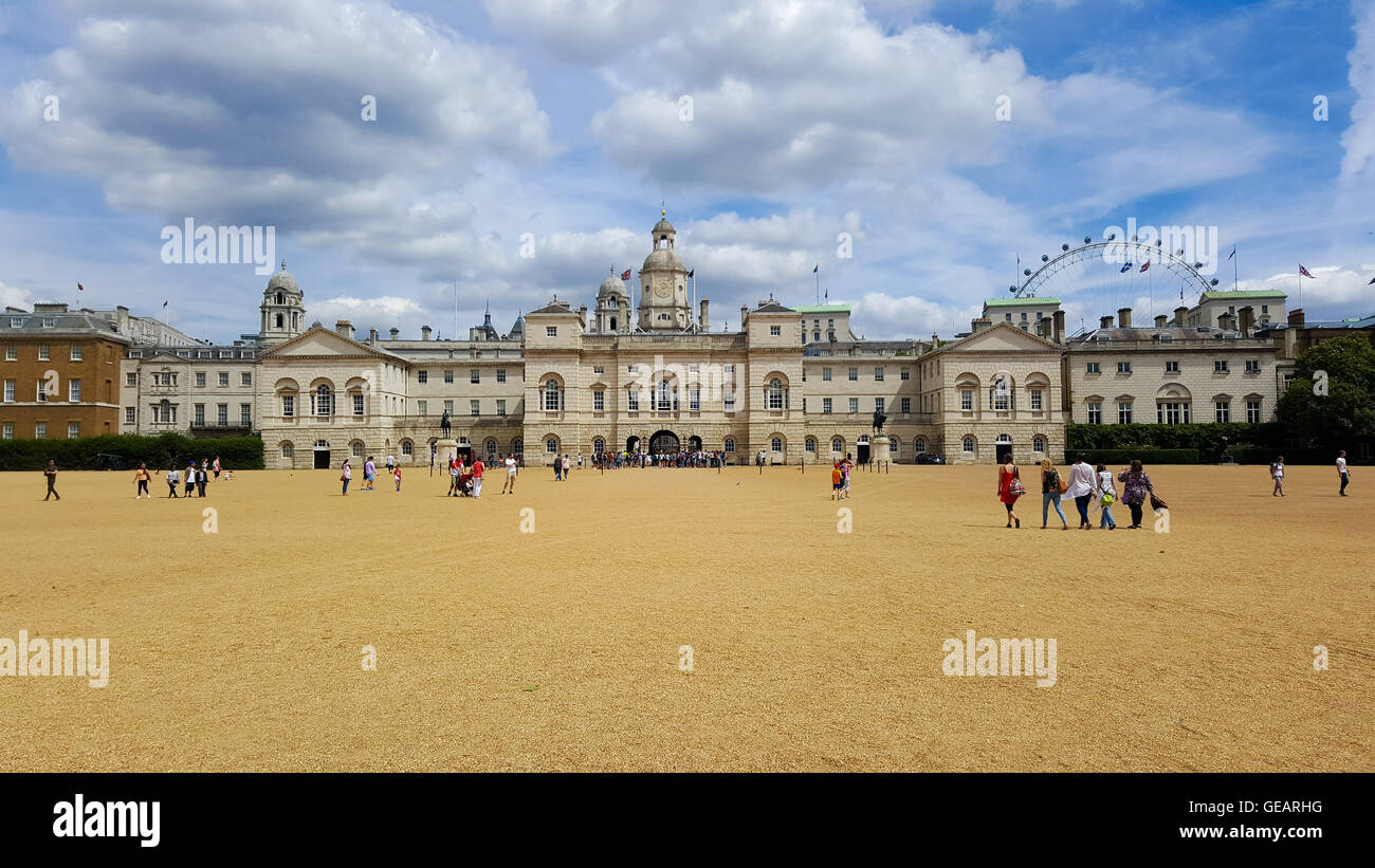 London, UK Weather 25 July 2016 - People enjoy a warm sunny day in Horse Guards Parade, Westminster. Stock Photo