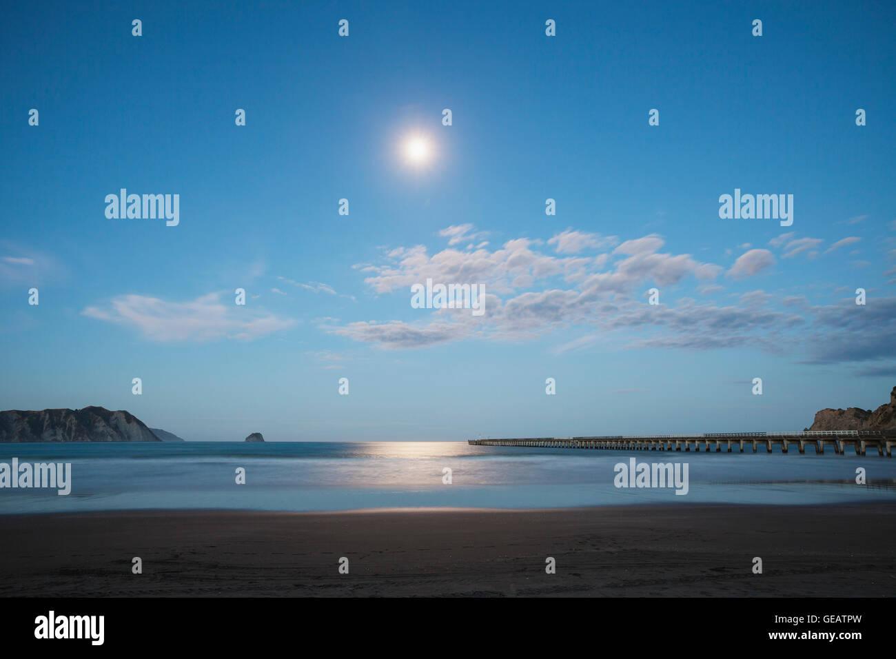 New Zealand, North Island, East Cape Region, Tolaga Bay, full moon, moonlight reflecting on ocean, South Pacific, - Stock Image