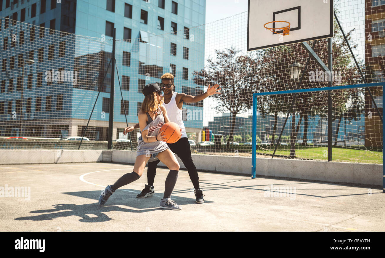 Young Couple Playing Basketball On Court Stock Photo 112108773 Alamy
